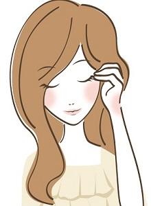 頭を触る女性の画像
